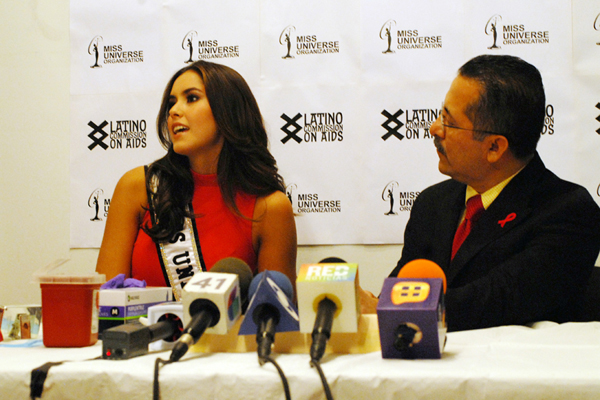 Miss Universe 2014 takes the HIV test at the Latino Commission on AIDS